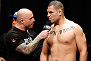 LAS VEGAS, NV - DECEMBER 28:  (R-L) UFC heavyweight title challenger Cain Velasquez is interviewed by Joe Rogan during the UFC 155 weigh-in on December 28, 2012 at MGM Grand Garden Arena in Las Vegas, Nevada. (Photo by Josh Hedges/Zuffa LLC/Zuffa LLC via Getty Images)