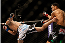 LAS VEGAS, NV - DECEMBER 29:  (L-R) Max Holloway kicks Leonard Garcia during their featherweight fight at UFC 155 on December 29, 2012 at MGM Grand Garden Arena in Las Vegas, Nevada. (Photo by Josh Hedges/Zuffa LLC/Zuffa LLC via Getty Images) *** Local Caption *** Leonard Garcia; Max Holloway