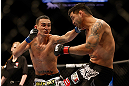 LAS VEGAS, NV - DECEMBER 29:  Max Holloway punches Leonard Garcia during their featherweight fight at UFC 155 on December 29, 2012 at MGM Grand Garden Arena in Las Vegas, Nevada. (Photo by Josh Hedges/Zuffa LLC/Zuffa LLC via Getty Images) *** Local Caption *** Leonard Garcia; Max Holloway
