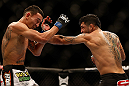 LAS VEGAS, NV - DECEMBER 29:  (R-L) Leonard Garcia punches Max Holloway during their featherweight fight at UFC 155 on December 29, 2012 at MGM Grand Garden Arena in Las Vegas, Nevada. (Photo by Josh Hedges/Zuffa LLC/Zuffa LLC via Getty Images) *** Local Caption *** Leonard Garcia; Max Holloway