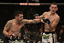 LAS VEGAS, NV - DECEMBER 29:  (L-R) Leonard Garcia punches Max Holloway during their featherweight fight at UFC 155 on December 29, 2012 at MGM Grand Garden Arena in Las Vegas, Nevada. (Photo by Donald Miralle/Zuffa LLC/Zuffa LLC via Getty Images) *** Local Caption *** Leonard Garcia; Max Holloway