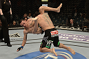 LAS VEGAS, NV - DECEMBER 29:  (R-L) Leonard Garcia slams Max Holloway during their featherweight fight at UFC 155 on December 29, 2012 at MGM Grand Garden Arena in Las Vegas, Nevada. (Photo by Donald Miralle/Zuffa LLC/Zuffa LLC via Getty Images) *** Local Caption *** Leonard Garcia; Max Holloway