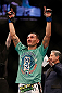 LAS VEGAS, NV - DECEMBER 29:  Max Holloway is declared the winner over Leonard Garcia after their featherweight fight at UFC 155 on December 29, 2012 at MGM Grand Garden Arena in Las Vegas, Nevada. (Photo by Josh Hedges/Zuffa LLC/Zuffa LLC via Getty Images) *** Local Caption *** Leonard Garcia; Max Holloway