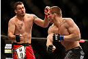 LAS VEGAS, NV - DECEMBER 29:  Todd Duffee (right) punches Phil De Fries during their heavyweight fight at UFC 155 on December 29, 2012 at MGM Grand Garden Arena in Las Vegas, Nevada. (Photo by Josh Hedges/Zuffa LLC/Zuffa LLC via Getty Images) *** Local Caption *** Phil De Fries; Todd Duffee