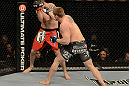 LAS VEGAS, NV - DECEMBER 29:  (R-L) Todd Duffee punches Phil De Fries during their heavyweight fight at UFC 155 on December 29, 2012 at MGM Grand Garden Arena in Las Vegas, Nevada. (Photo by Donald Miralle/Zuffa LLC/Zuffa LLC via Getty Images) *** Local Caption *** Phil De Fries; Todd Duffee