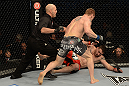 LAS VEGAS, NV - DECEMBER 29:  Todd Duffee (gray shorts) attempts to finish Phil De Fries (red shorts) during their heavyweight fight at UFC 155 on December 29, 2012 at MGM Grand Garden Arena in Las Vegas, Nevada. (Photo by Donald Miralle/Zuffa LLC/Zuffa LLC via Getty Images) *** Local Caption *** Phil De Fries; Todd Duffee