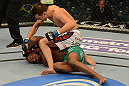 LAS VEGAS, NV - DECEMBER 29:  Myles Jury (top) punches Michael Johnson during their lightweight fight at UFC 155 on December 29, 2012 at MGM Grand Garden Arena in Las Vegas, Nevada. (Photo by Donald Miralle/Zuffa LLC/Zuffa LLC via Getty Images) *** Local Caption *** Michael Johnson; Myles Jury