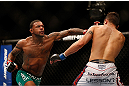 LAS VEGAS, NV - DECEMBER 29:  (L-R) Michael Johnson punches Myles Jury during their lightweight fight at UFC 155 on December 29, 2012 at MGM Grand Garden Arena in Las Vegas, Nevada. (Photo by Josh Hedges/Zuffa LLC/Zuffa LLC via Getty Images) *** Local Caption *** Michael Johnson; Myles Jury