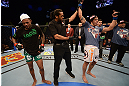 LAS VEGAS, NV - DECEMBER 29:  Myles Jury (right) is declared the winner in his fight against Michael Johnson (left) after their lightweight fight at UFC 155 on December 29, 2012 at MGM Grand Garden Arena in Las Vegas, Nevada. (Photo by Donald Miralle/Zuffa LLC/Zuffa LLC via Getty Images) *** Local Caption *** Michael Johnson; Myles Jury