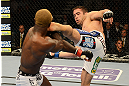 LAS VEGAS, NV - DECEMBER 29:  (R-L) Jamie Varner kicks Melvin Guillard during their lightweight fight at UFC 155 on December 29, 2012 at MGM Grand Garden Arena in Las Vegas, Nevada. (Photo by Donald Miralle/Zuffa LLC/Zuffa LLC via Getty Images) *** Local Caption *** Melvin Guillard; Jamie Varner