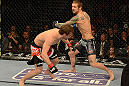LAS VEGAS, NV - DECEMBER 29:  (R-L) Eddie Wineland punches Brad Pickett during their bantamweight fight at UFC 155 on December 29, 2012 at MGM Grand Garden Arena in Las Vegas, Nevada. (Photo by Donald Miralle/Zuffa LLC/Zuffa LLC via Getty Images) *** Local Caption *** Brad Pickett; Eddie Wineland