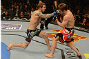 LAS VEGAS, NV - DECEMBER 29:  (L-R) Eddie Wineland punches Brad Pickett during their bantamweight fight at UFC 155 on December 29, 2012 at MGM Grand Garden Arena in Las Vegas, Nevada. (Photo by Donald Miralle/Zuffa LLC/Zuffa LLC via Getty Images) *** Local Caption *** Brad Pickett; Eddie Wineland