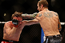 LAS VEGAS, NV - DECEMBER 29:  (R-L) Eddie Wineland punches Brad Pickett during their bantamweight fight at UFC 155 on December 29, 2012 at MGM Grand Garden Arena in Las Vegas, Nevada. (Photo by Josh Hedges/Zuffa LLC/Zuffa LLC via Getty Images) *** Local Caption *** Brad Pickett; Eddie Wineland