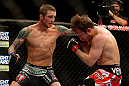 LAS VEGAS, NV - DECEMBER 29:  (L-R) Eddie Wineland punches Brad Pickett during their bantamweight fight at UFC 155 on December 29, 2012 at MGM Grand Garden Arena in Las Vegas, Nevada. (Photo by Josh Hedges/Zuffa LLC/Zuffa LLC via Getty Images) *** Local Caption *** Brad Pickett; Eddie Wineland