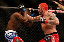 LAS VEGAS, NV - DECEMBER 29:  Chris Leben punches Derek Brunson during their middleweight fight at UFC 155 on December 29, 2012 at MGM Grand Garden Arena in Las Vegas, Nevada. (Photo by Josh Hedges/Zuffa LLC/Zuffa LLC via Getty Images) *** Local Caption *** Chris Leben; Derek Brunson