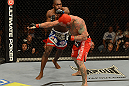 LAS VEGAS, NV - DECEMBER 29:  Derek Brunson (left) punches Chris Leben during their middleweight fight at UFC 155 on December 29, 2012 at MGM Grand Garden Arena in Las Vegas, Nevada. (Photo by Donald Miralle/Zuffa LLC/Zuffa LLC via Getty Images) *** Local Caption *** Chris Leben; Derek Brunson