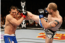 LAS VEGAS, NV - DECEMBER 29:  (R-L) Alan Belcher kicks Yushin Okami during their middleweight fight at UFC 155 on December 29, 2012 at MGM Grand Garden Arena in Las Vegas, Nevada. (Photo by Josh Hedges/Zuffa LLC/Zuffa LLC via Getty Images) *** Local Caption *** Yushin Okami; Alan Belcher
