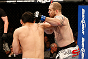 LAS VEGAS, NV - DECEMBER 29:  (L-R) Yushin Okami punches Alan Belcher during their middleweight fight at UFC 155 on December 29, 2012 at MGM Grand Garden Arena in Las Vegas, Nevada. (Photo by Josh Hedges/Zuffa LLC/Zuffa LLC via Getty Images) *** Local Caption *** Yushin Okami; Alan Belcher