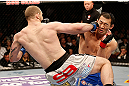 LAS VEGAS, NV - DECEMBER 29:  (L-R) Alan Belcher punches Yushin Okami during their middleweight fight at UFC 155 on December 29, 2012 at MGM Grand Garden Arena in Las Vegas, Nevada. (Photo by Josh Hedges/Zuffa LLC/Zuffa LLC via Getty Images) *** Local Caption *** Yushin Okami; Alan Belcher