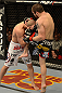 LAS VEGAS, NV - DECEMBER 29:  (R-L) Jim Miller knees Joe Lauzon during their lightweight fight at UFC 155 on December 29, 2012 at MGM Grand Garden Arena in Las Vegas, Nevada. (Photo by Donald Miralle/Zuffa LLC/Zuffa LLC via Getty Images) *** Local Caption *** Joe Lauzon; Jim Miller