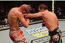 LAS VEGAS, NV - DECEMBER 29:  (R-L) Jim Miller punches Joe Lauzon during their lightweight fight at UFC 155 on December 29, 2012 at MGM Grand Garden Arena in Las Vegas, Nevada. (Photo by Donald Miralle/Zuffa LLC/Zuffa LLC via Getty Images) *** Local Caption *** Joe Lauzon; Jim Miller