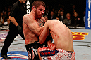 LAS VEGAS, NV - DECEMBER 29:  (L-R) Jim Miller knees Joe Lauzon during their lightweight fight at UFC 155 on December 29, 2012 at MGM Grand Garden Arena in Las Vegas, Nevada. (Photo by Josh Hedges/Zuffa LLC/Zuffa LLC via Getty Images) *** Local Caption *** Joe Lauzon; Jim Miller