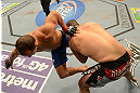 LAS VEGAS, NV - DECEMBER 29:  (R-L) Cain Velasquez takes down Junior dos Santos during their heavyweight championship fight at UFC 155 on December 29, 2012 at MGM Grand Garden Arena in Las Vegas, Nevada. (Photo by Donald Miralle/Zuffa LLC/Zuffa LLC via Getty Images) *** Local Caption *** Junior dos Santos; Cain Velasquez