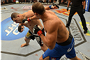 LAS VEGAS, NV - DECEMBER 29:  (R-L) Junior dos Santos punches Cain Velasquez during their heavyweight championship fight at UFC 155 on December 29, 2012 at MGM Grand Garden Arena in Las Vegas, Nevada. (Photo by Donald Miralle/Zuffa LLC/Zuffa LLC via Getty Images) *** Local Caption *** Junior dos Santos; Cain Velasquez