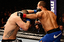LAS VEGAS, NV - DECEMBER 29:  (L-R) Cain Velasquez punches Junior dos Santos during their heavyweight championship fight at UFC 155 on December 29, 2012 at MGM Grand Garden Arena in Las Vegas, Nevada. (Photo by Josh Hedges/Zuffa LLC/Zuffa LLC via Getty Images) *** Local Caption *** Junior dos Santos; Cain Velasquez