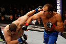LAS VEGAS, NV - DECEMBER 29:  (R-L) Junior dos Santos punches Cain Velasquez during their heavyweight championship fight at UFC 155 on December 29, 2012 at MGM Grand Garden Arena in Las Vegas, Nevada. (Photo by Josh Hedges/Zuffa LLC/Zuffa LLC via Getty Images) *** Local Caption *** Junior dos Santos; Cain Velasquez