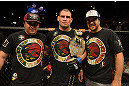 LAS VEGAS, NV - DECEMBER 29:  Cain Velasquez poses with his teammates after his heavyweight championship fight against Junior dos Santos at UFC 155 on December 29, 2012 at MGM Grand Garden Arena in Las Vegas, Nevada. (Photo by Donald Miralle/Zuffa LLC/Zuffa LLC via Getty Images) *** Local Caption *** Junior dos Santos; Cain Velasquez