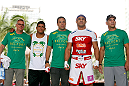 SAO PAULO, BRAZIL - JANUARY 16:  Vitor Belfort (second from right) poses for photos with his team after an open workout session for media and fans on January 16, 2013 at Parque Anhangabau in Sao Paulo, Brazil. (Photo by Josh Hedges/Zuffa LLC/Zuffa LLC via Getty Images)