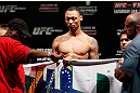 SAO PAULO, BRAZIL - JANUARY 18:  C.J. Keith weighs in during the UFC on FX official weigh-in event on January 18, 2013 at Ibirapuera Gymnasium in Sao Paulo, Brazil. (Photo by Josh Hedges/Zuffa LLC/Zuffa LLC via Getty Images)