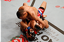 SAO PAULO, BRAZIL - JANUARY 19:  Francisco Trinaldo (top) punches C.J. Keith in their lightweight fight at the UFC on FX event on January 19, 2013 at Ibirapuera Gymnasium in Sao Paulo, Brazil. (Photo by Josh Hedges/Zuffa LLC/Zuffa LLC via Getty Images)