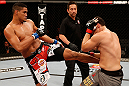 SAO PAULO, BRAZIL - JANUARY 19:  (L-R) Ildemar Alcantara kicks Wagner Prado in their light heavyweight fight at the UFC on FX event on January 19, 2013 at Ibirapuera Gymnasium in Sao Paulo, Brazil. (Photo by Josh Hedges/Zuffa LLC/Zuffa LLC via Getty Images)