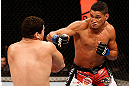 SAO PAULO, BRAZIL - JANUARY 19:  (R-L) Ildemar Alcantara punches Wagner Prado in their light heavyweight fight at the UFC on FX event on January 19, 2013 at Ibirapuera Gymnasium in Sao Paulo, Brazil. (Photo by Josh Hedges/Zuffa LLC/Zuffa LLC via Getty Images)