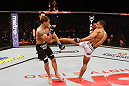SAO PAULO, BRAZIL - JANUARY 19:  (R-L) Edson Barboza kicks Lucas Martins in their lightweight fight at the UFC on FX event on January 19, 2013 at Ibirapuera Gymnasium in Sao Paulo, Brazil. (Photo by Josh Hedges/Zuffa LLC/Zuffa LLC via Getty Images)