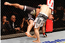 SAO PAULO, BRAZIL - JANUARY 19:  Nik Lentz (white shorts) takes down Diego Nunes in their featherweight fight at the UFC on FX event on January 19, 2013 at Ibirapuera Gymnasium in Sao Paulo, Brazil. (Photo by Josh Hedges/Zuffa LLC/Zuffa LLC via Getty Images)