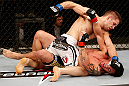 SAO PAULO, BRAZIL - JANUARY 19:  Nik Lentz (white shorts) punches Diego Nunes in their featherweight fight at the UFC on FX event on January 19, 2013 at Ibirapuera Gymnasium in Sao Paulo, Brazil. (Photo by Josh Hedges/Zuffa LLC/Zuffa LLC via Getty Images)