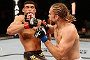 SAO PAULO, BRAZIL - JANUARY 19:  (R-L) Andrew Craig punches Ronny Markes in their middleweight fight at the UFC on FX event on January 19, 2013 at Ibirapuera Gymnasium in Sao Paulo, Brazil. (Photo by Josh Hedges/Zuffa LLC/Zuffa LLC via Getty Images)