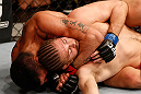 SAO PAULO, BRAZIL - JANUARY 19:  (L-R) Ronny Markes attempts a rear choke submission against Andrew Craig in their middleweight fight at the UFC on FX event on January 19, 2013 at Ibirapuera Gymnasium in Sao Paulo, Brazil. (Photo by Josh Hedges/Zuffa LLC/Zuffa LLC via Getty Images)