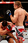 SAO PAULO, BRAZIL - JANUARY 19:  (R-L) Andrew Craig delivers a flying knee against Ronny Markes in their middleweight fight at the UFC on FX event on January 19, 2013 at Ibirapuera Gymnasium in Sao Paulo, Brazil. (Photo by Josh Hedges/Zuffa LLC/Zuffa LLC via Getty Images)