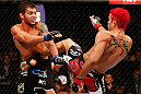 "SAO PAULO, BRAZIL - JANUARY 19:  (R-L) Godofredo ""Pepey"" Castro kicks Milton Vieira in their featherweight fight at the UFC on FX event on January 19, 2013 at Ibirapuera Gymnasium in Sao Paulo, Brazil. (Photo by Josh Hedges/Zuffa LLC/Zuffa LLC via Getty Images)"