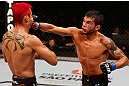"SAO PAULO, BRAZIL - JANUARY 19:  (R-L) Milton Vieira punches Godofredo ""Pepey"" Castro in their featherweight fight at the UFC on FX event on January 19, 2013 at Ibirapuera Gymnasium in Sao Paulo, Brazil. (Photo by Josh Hedges/Zuffa LLC/Zuffa LLC via Getty Images)"