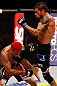 SAO PAULO, BRAZIL - JANUARY 19:  (R-L) Milton Vieira delivers a flying knee against Godofredo &quot;Pepey&quot; Castro in their featherweight fight at the UFC on FX event on January 19, 2013 at Ibirapuera Gymnasium in Sao Paulo, Brazil. (Photo by Josh Hedges/Zuffa LLC/Zuffa LLC via Getty Images)