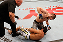 SAO PAULO, BRAZIL - JANUARY 19:  Khabib Nurmagomedov (top) punches Thiago Tavares in their lightweight fight at the UFC on FX event on January 19, 2013 at Ibirapuera Gymnasium in Sao Paulo, Brazil. (Photo by Josh Hedges/Zuffa LLC/Zuffa LLC via Getty Images)