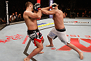 SAO PAULO, BRAZIL - JANUARY 19:  (R-L) Ben Rothwell punches Gabriel Gonzaga in their heavyweight fight at the UFC on FX event on January 19, 2013 at Ibirapuera Gymnasium in Sao Paulo, Brazil. (Photo by Josh Hedges/Zuffa LLC/Zuffa LLC via Getty Images)