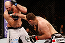 SAO PAULO, BRAZIL - JANUARY 19:  (R-L) Gabriel Gonzaga punches Ben Rothwell  in their heavyweight fight at the UFC on FX event on January 19, 2013 at Ibirapuera Gymnasium in Sao Paulo, Brazil. (Photo by Josh Hedges/Zuffa LLC/Zuffa LLC via Getty Images)