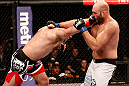 SAO PAULO, BRAZIL - JANUARY 19:  (L-R) Gabriel Gonzaga punches Ben Rothwell  in their heavyweight fight at the UFC on FX event on January 19, 2013 at Ibirapuera Gymnasium in Sao Paulo, Brazil. (Photo by Josh Hedges/Zuffa LLC/Zuffa LLC via Getty Images)