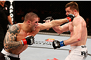 SAO PAULO, BRAZIL - JANUARY 19:  (L-R) Daniel Sarafian punches C.B. Dolloway in their middleweight fight at the UFC on FX event on January 19, 2013 at Ibirapuera Gymnasium in Sao Paulo, Brazil. (Photo by Josh Hedges/Zuffa LLC/Zuffa LLC via Getty Images)